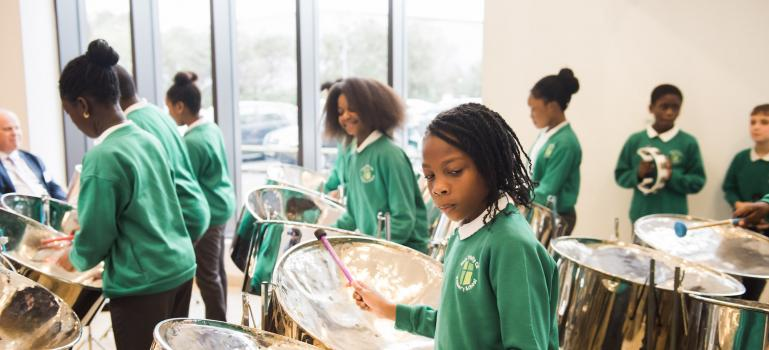 students playing steel drums - mobile