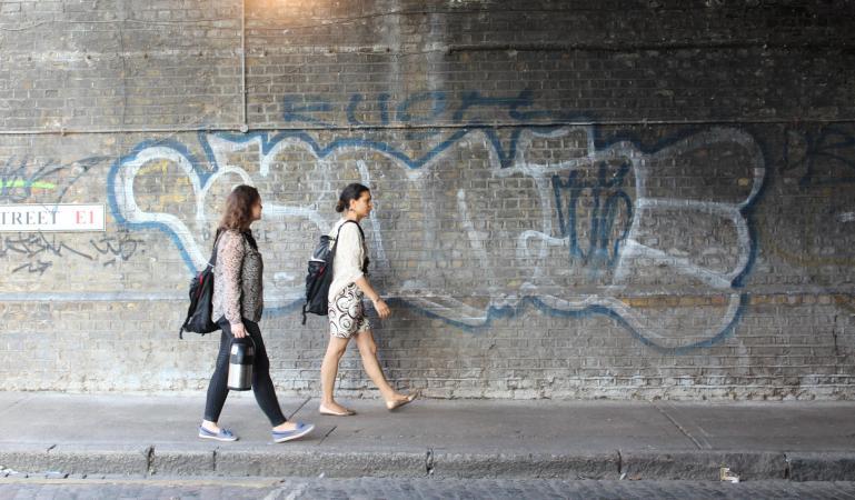 women walking in street